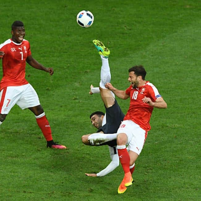 France   s Adil Rami  attempts an overhead kick during UEFA EURO 2016 Group A match