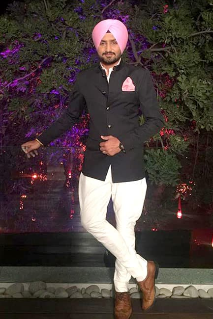 Harbhajan Singh poses for a photo during his reception