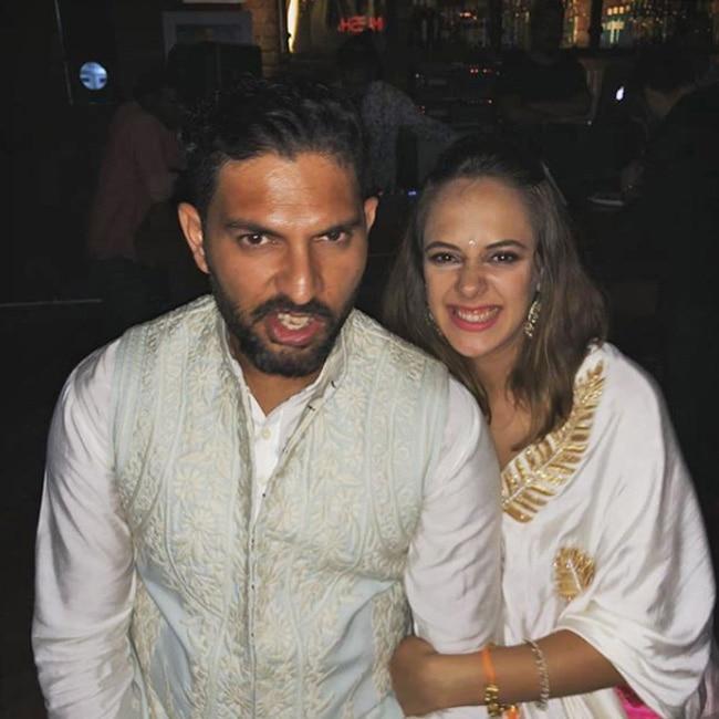 Hazel Keech and Yuvraj Singh at an event