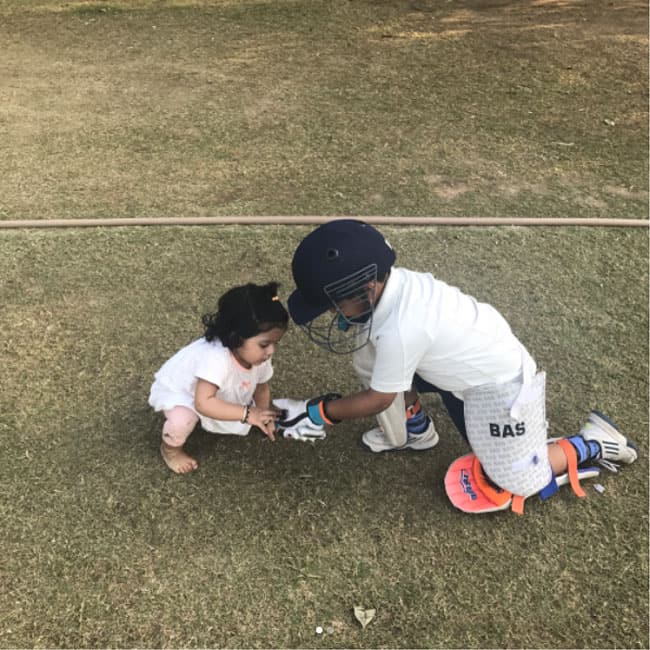 Hinaya Singh with a student of Harbhajan Singh Cricket academy