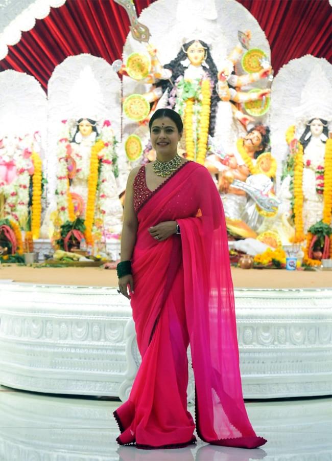 Kajol begins Pandal hopping on Durga Puja in a bright pink saree