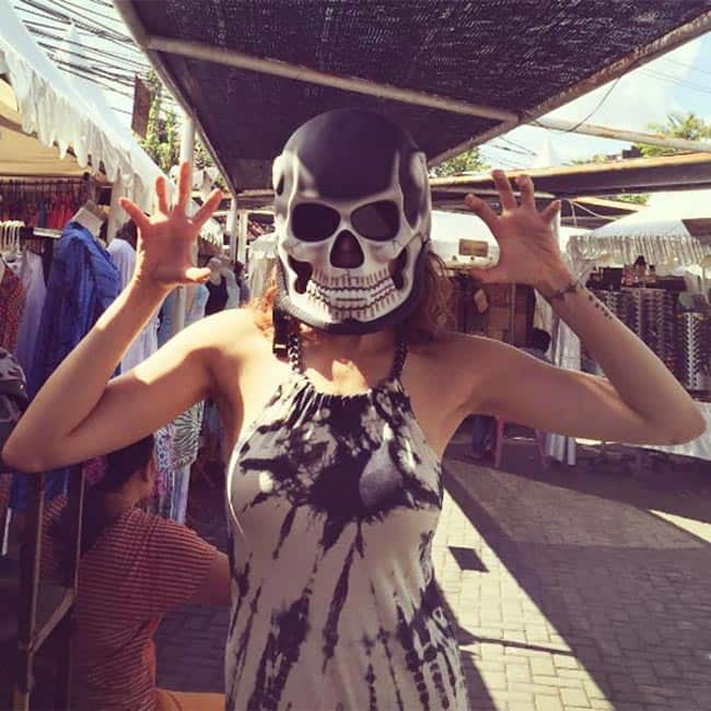 Karishma Tanna posing with a mask in Bali