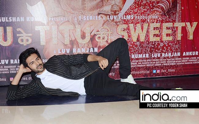 Karthik Aryan posing for photogs at success bash of Sonu Ke Titu Ki Sweety