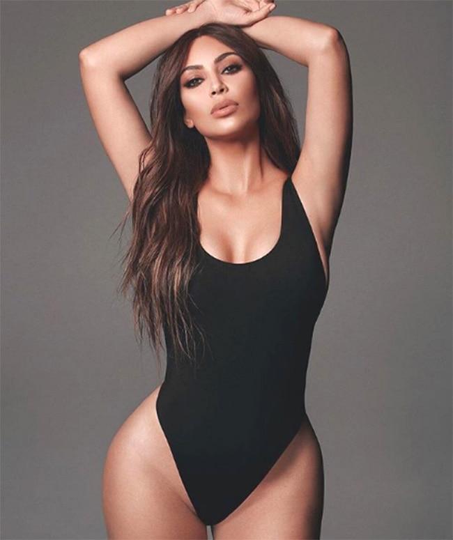Kim Kardashian oozing charm in sexy black swimsuit