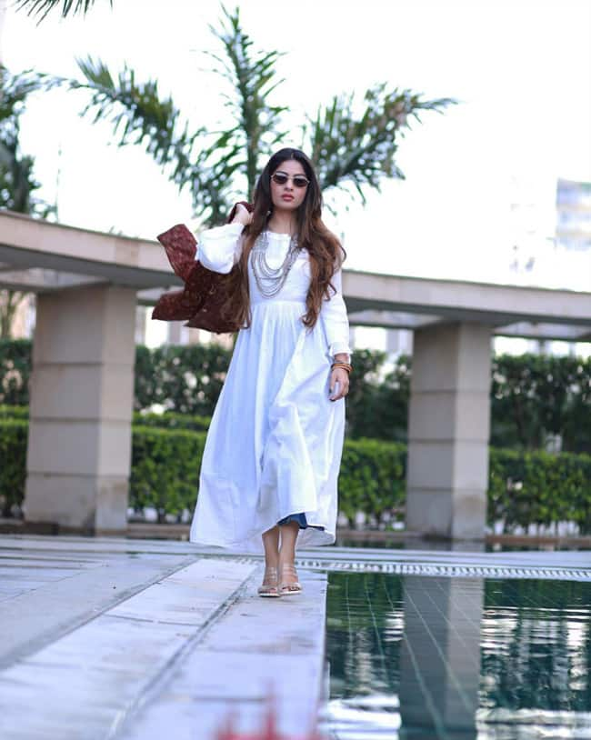 Krishna Mukherjee Swags it up in White Dress And Sunglasses