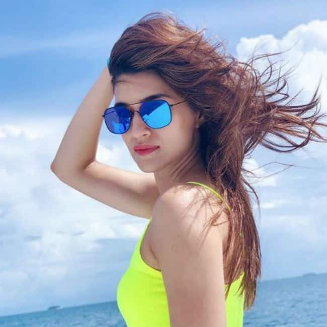 Kriti Sanon Looks Gorgeous in Neon Tank Top And Denim Shorts as She Vacays in Maldives With Friends