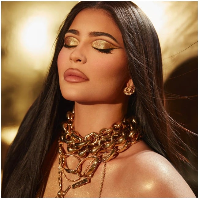 Kylie Jenner smears gold dust all over her body to promote her new cosmetic collection