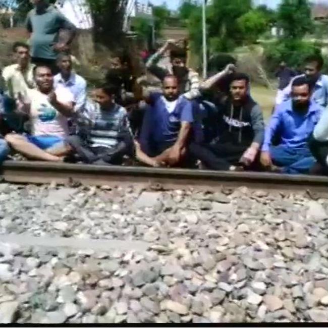 Locals of Samba block railways tracks
