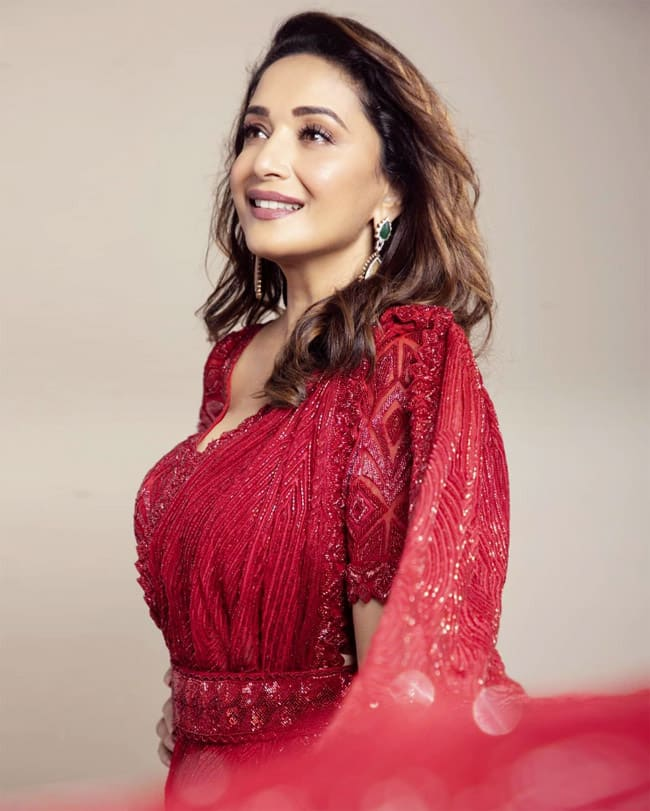 Madhuri Dixit looks gorgeous as ever in THIS beautiful and sexy red saree