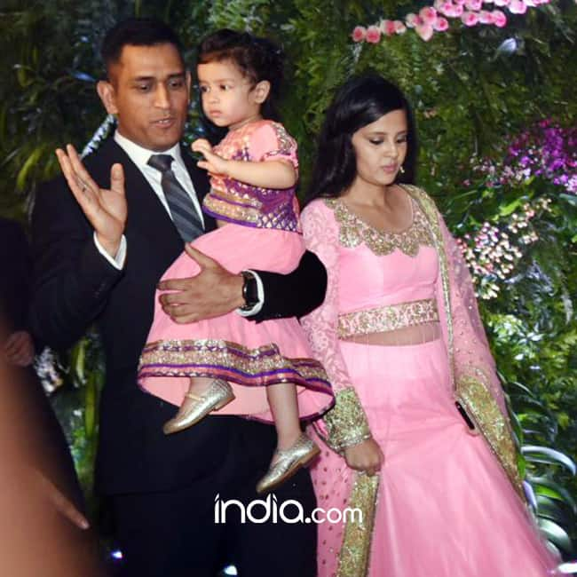 Mahendra Singh Dhoni with wife and daughter at Virat Kohli and Anushka Sharma   s reception