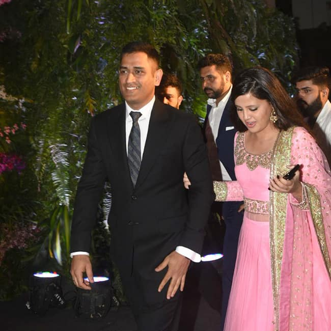 Mahendra Singh Dhoni with wife Sakshi Dhoni at Virat Kohli   s wedding reception