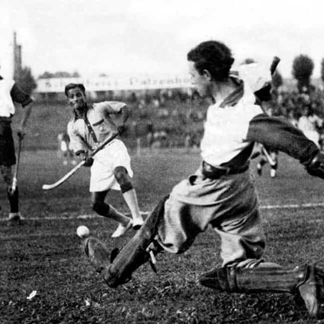 Major Dhyanchand playing hockey on field