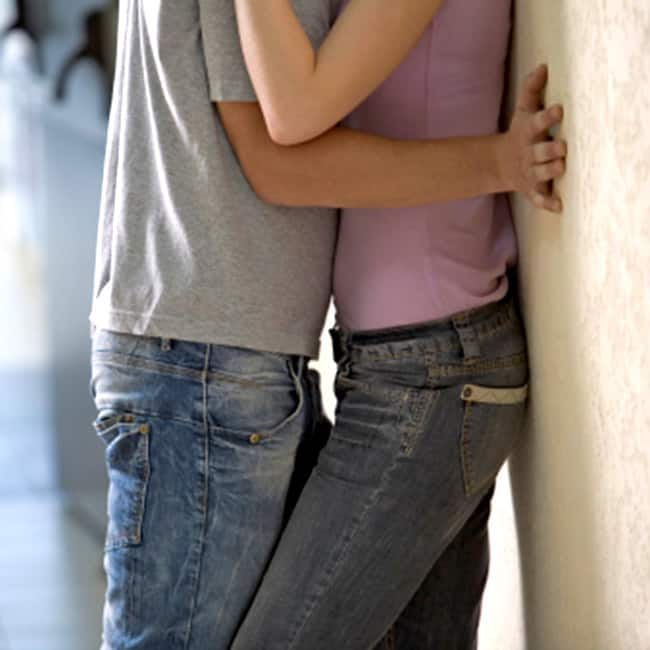 Make your girl lean against the wall while doing standing sex position