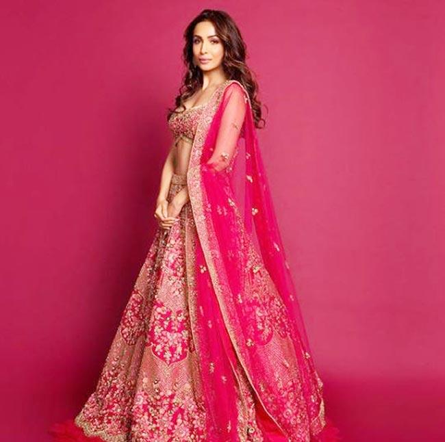 Malaika Arora Looks Drop dead Gorgeous in Heavy Embellishment Pink Lehenga
