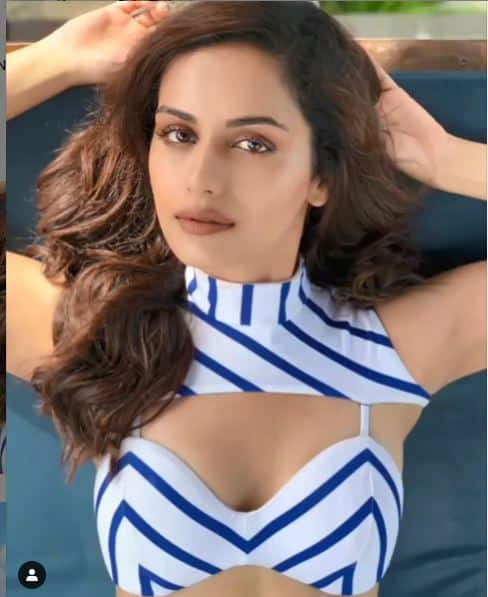 Manushi Chillar looks hot in a white and blue striped bikini