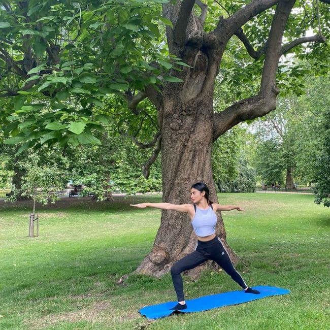 Mouni Roy does yoga in a park
