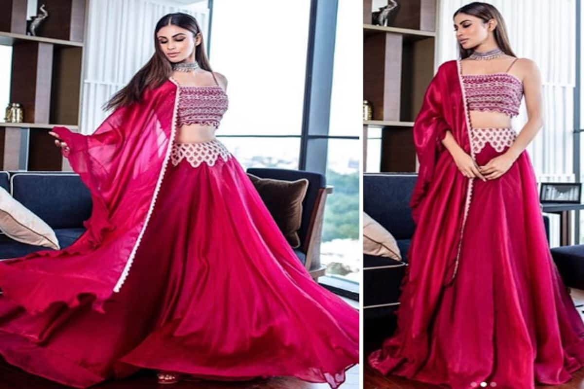 https://st1.photogallery.ind.sh/wp-content/uploads/indiacom/mouni-roy-in-beautiful-pink-lehenga-for-made-in-china-promotions-201910-1570113206.jpg?impolicy=Medium_Resize&w=1200&h=800