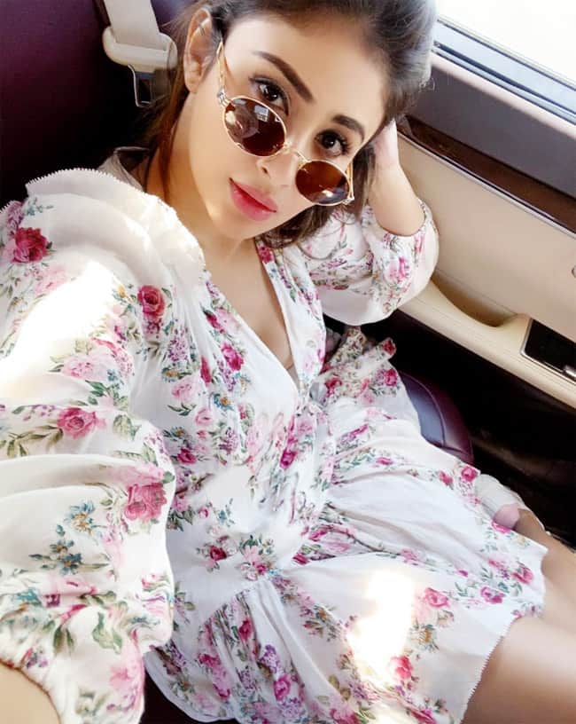 Mouni Roy in Simple White Floral Dress