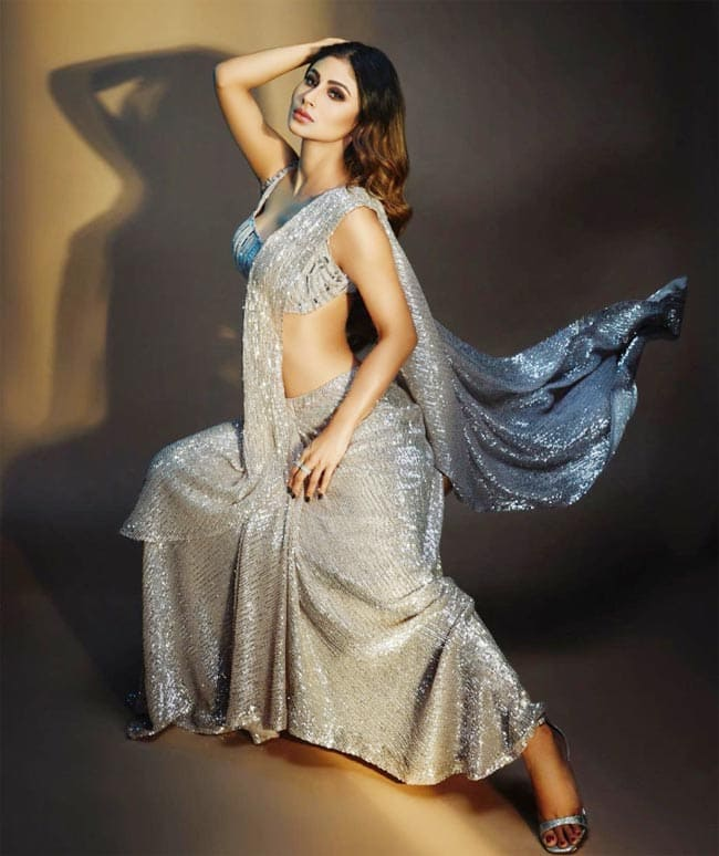 Mouni Roy promotes her upcoming music video looking stellar in a silver sequin saree