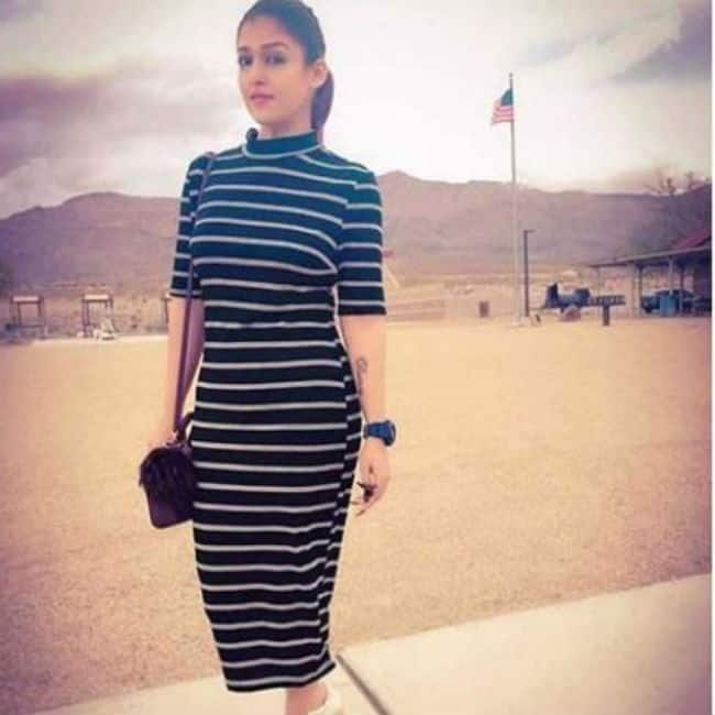 Nayanthara looks hot and sexy in black and white striped dress