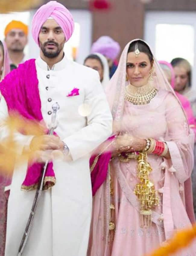 Neha Dhupia and Angad Bedi snapped during their wedding