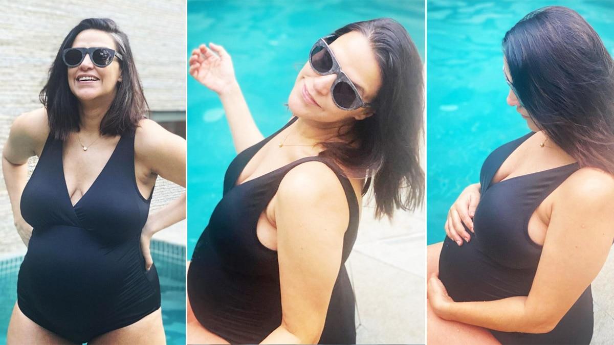 Neha Dhupia is Setting Some Major Maternity Fashion in Black Swimsuit