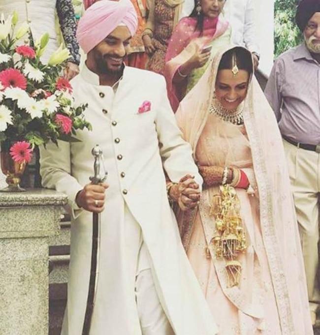 Neha Dhupia with husband Angad Bedi post her wedding