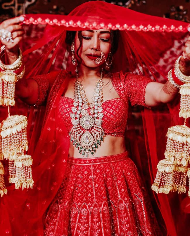 Neha Kakkar looks inspired by Priyanka Chopra's rose bridal look at her wedding