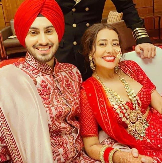 Neha Kakkar wears a red lehenga at her wedding