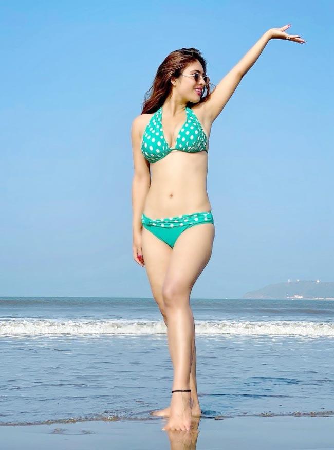 Neha Malik flaunts her curves in blue polka dot bikini