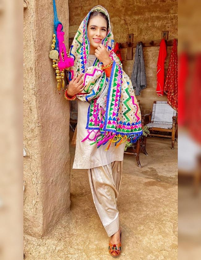 Neha Malik gives a sneak peek of village life  wears phulkari duatta