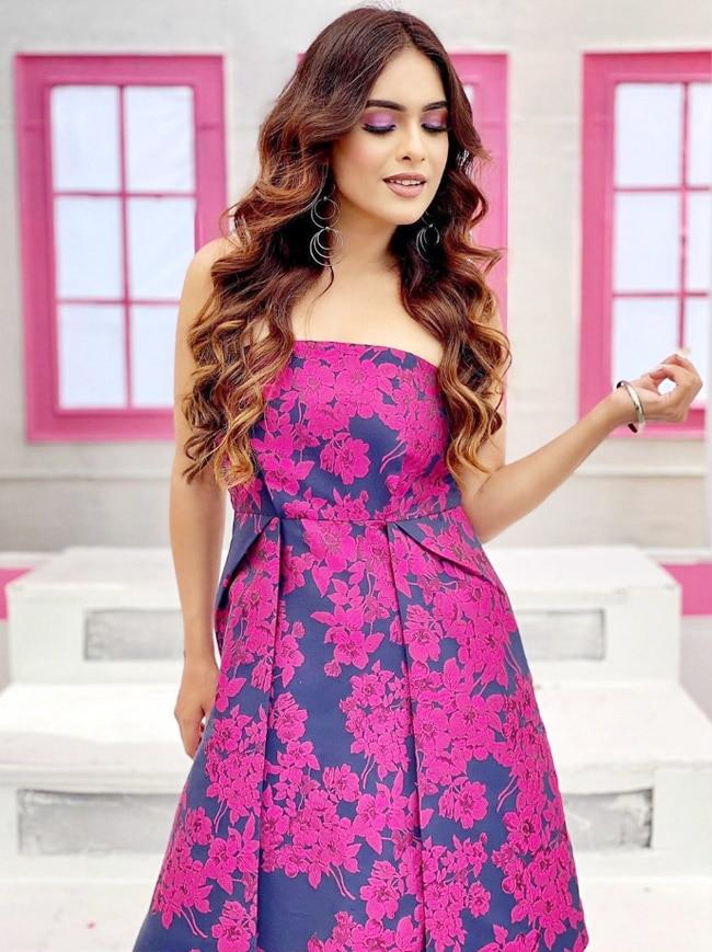 Neha Malik looks pretty in a colourful off shoulder dress