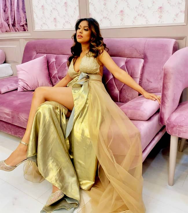 Nia Sharma drops sizzling pictures of herself posing in a sexy golden gown