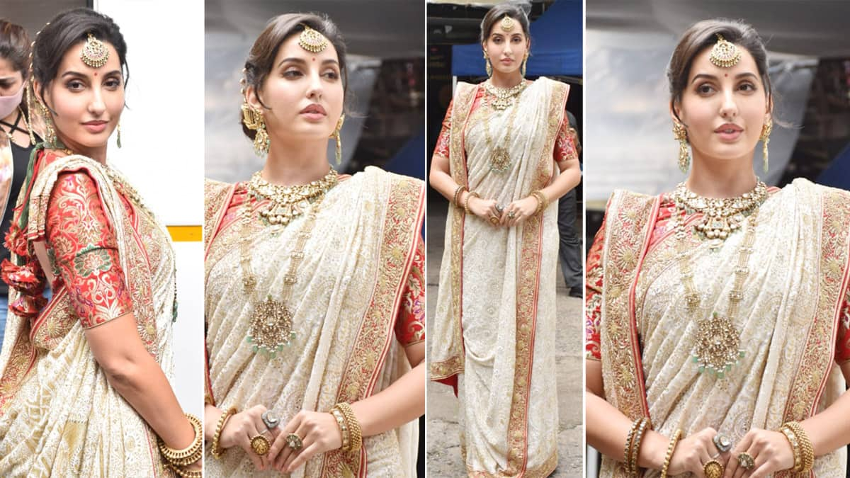 Nora Fatehi gives a dose of ethnic style inspiration in heavy white embellished saree with red blouse