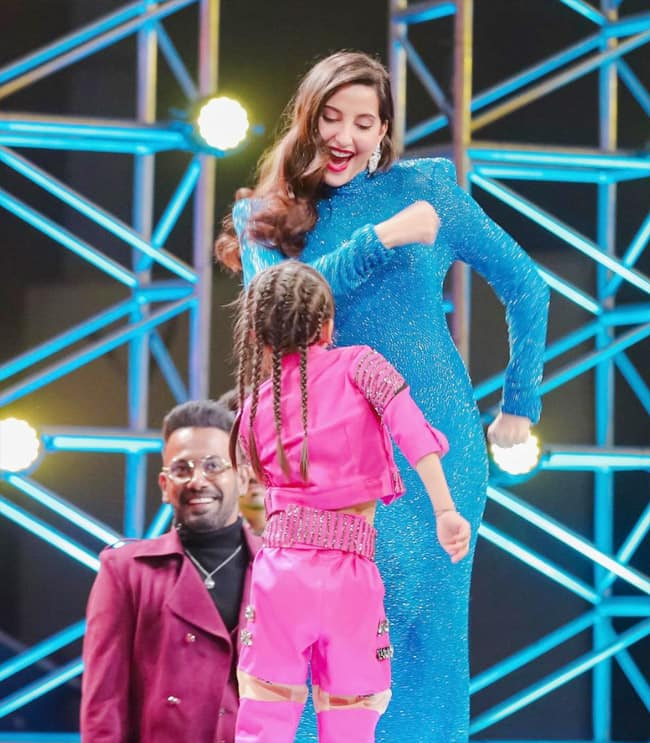 Nora Fatehi looks all sparkly and stunning in her blue Naeem Khan gown on Dance Deewane 3