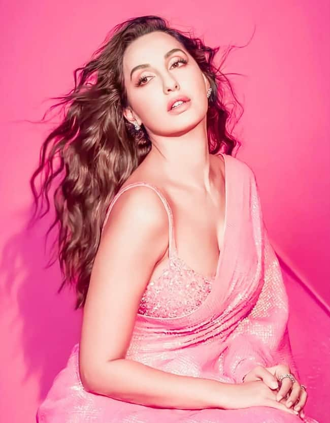 Nora Fatehi Looks Drop-Dead Gorgeous in Her Pink Shiny Saree And Bright Studded Bralette