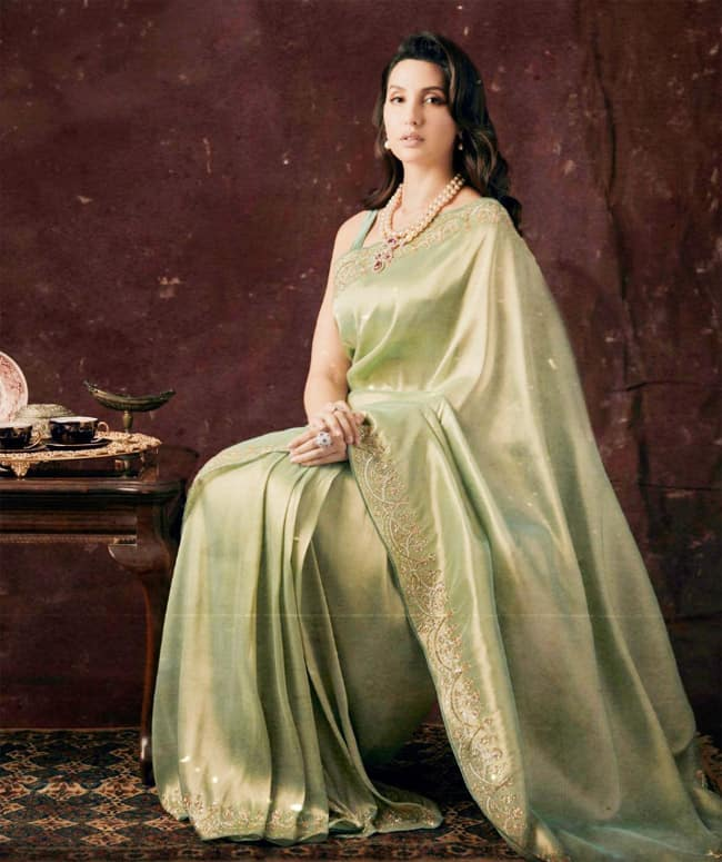 Nora Fatehi looks sizzling in a green saree
