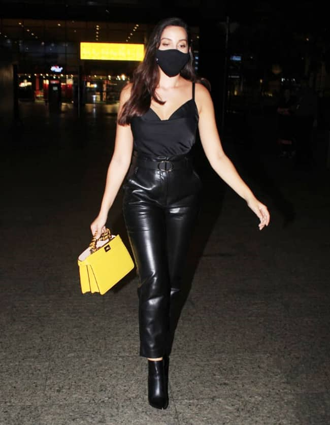 Nora Fatehi rocks her black on black look in latest pictures from airport