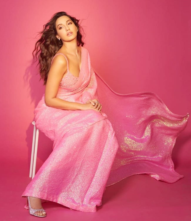 Nora Fatehi Shines Bright in a Beautiful Sequin Saree