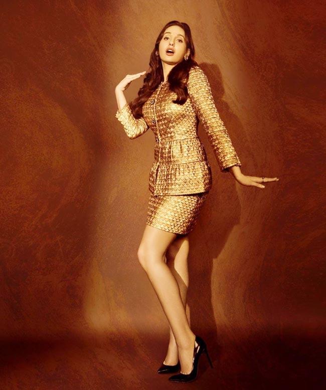 Nora Fatehi wears a shiny skirt with a peplum top