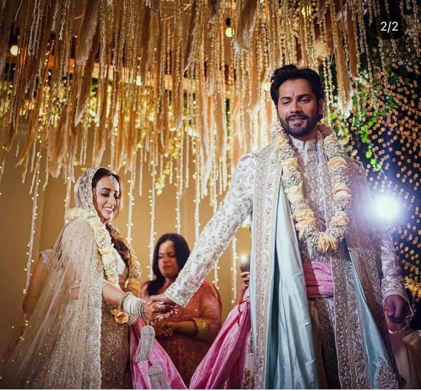 Paparazzi clicked the newlyweds Varun Dhawan   Natasha Dalal as they came out to pose