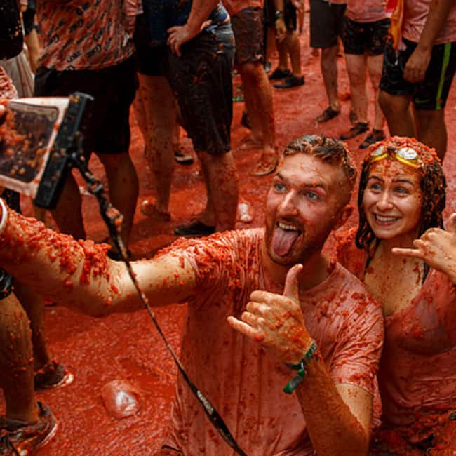 People taking selfie while enjoying during annual 2017 La Tomatina festival in Spain