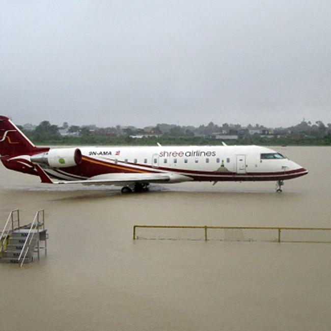 Plane makes landing in flood hot Nepal