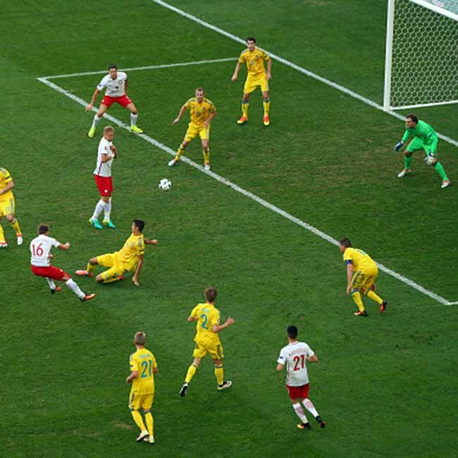 Poland   s Jakub Blaszczykowski scores the first goal against Ukraine in UEFA EURO 2016