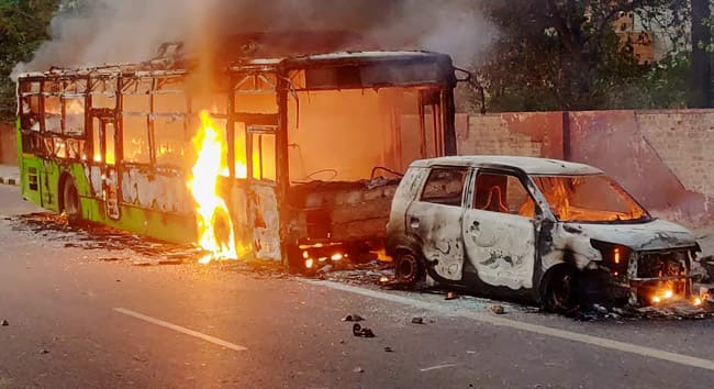 Protestors Set Fire on DTC Buses