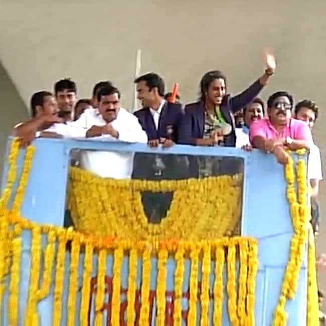 P V Sindhu waving at her fans on streets of Hyderabad