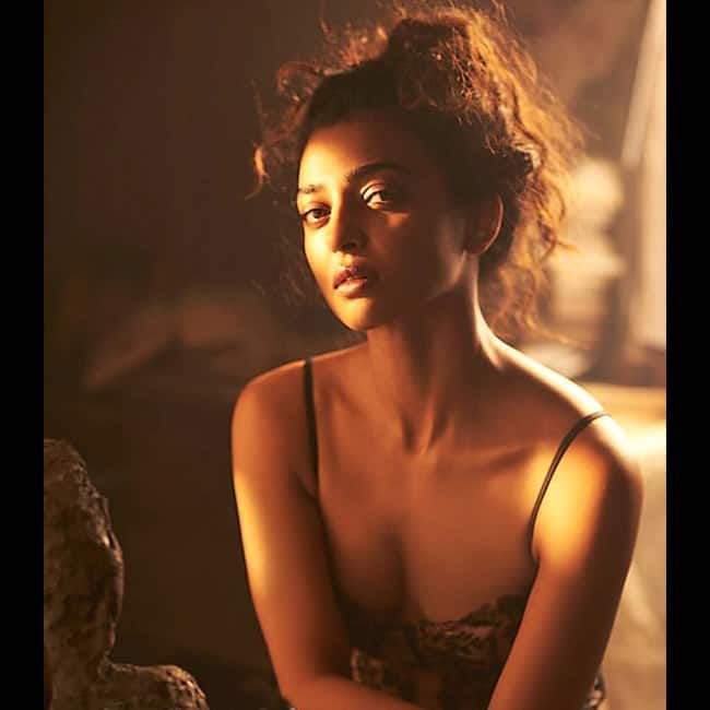 Radhika Apte flaunting cleavage in sensuous shoot