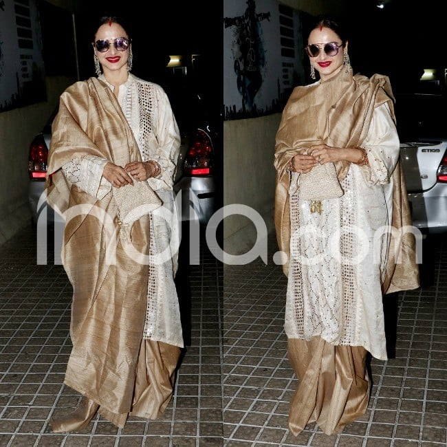 Rekha in her stunning golden look and bold red lips