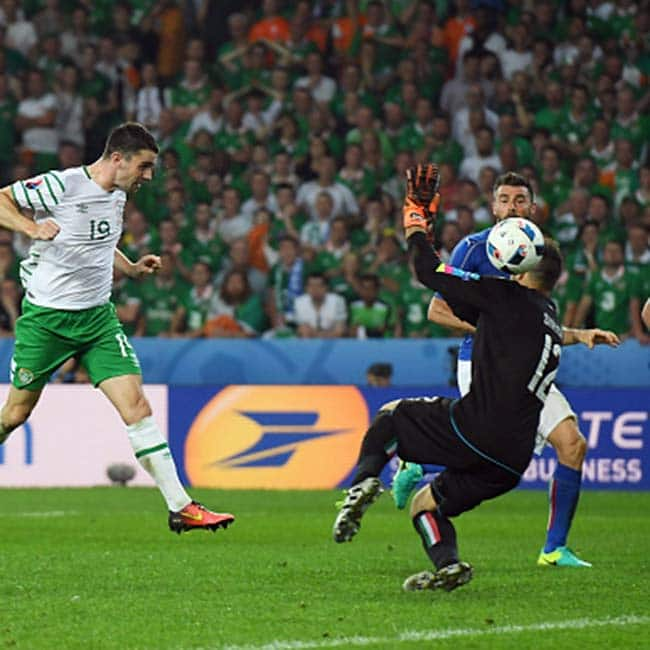 Republic of Ireland   s Robbie Brady heads the ball to score the first goal against Italy
