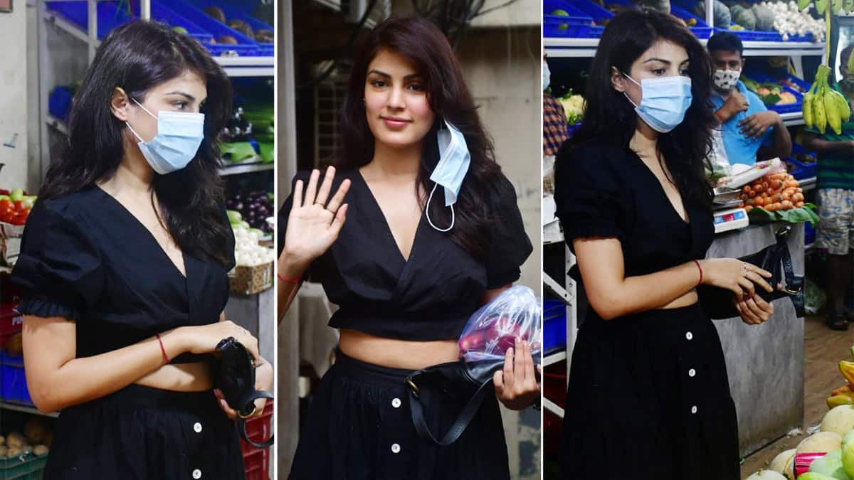 Rhea Chakraborty wore a cool black crop top with long skirt as she goes to buy grocery
